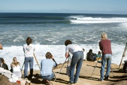 photographers on beach photographing waves and surfers