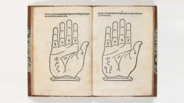 open book showing diagram of hands