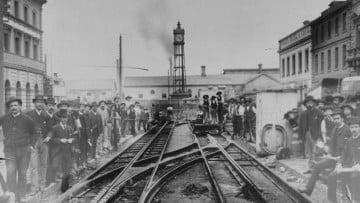 1920s photo of men standing near tram tracks