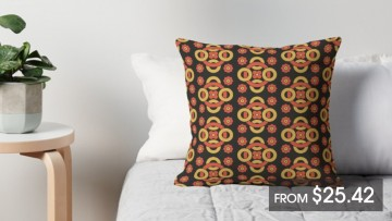 A square cushion with a brown geometric pattern on a bed with a price listing