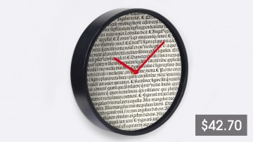 A wall clock with a black frame and a price listing