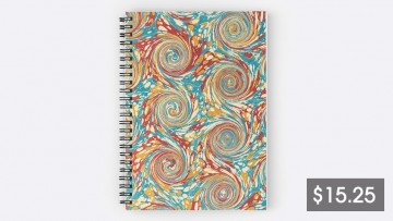 Spiral notebook with swirling marbled pattern and price tag