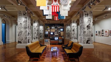 sofas, posters, T-shirts and artworks part of State Library Victoria's summer 2016 3RRR On Air exhibition