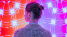 Curious women in front of glowing pink and red background
