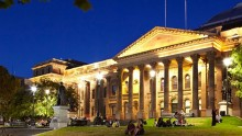 colour photo of State Library facade at night