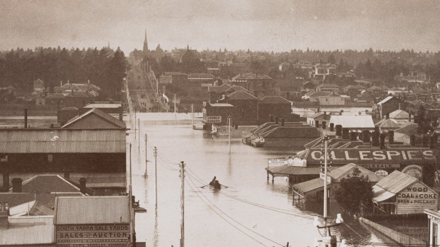 A single row boat floats down a flooded Melbourne street
