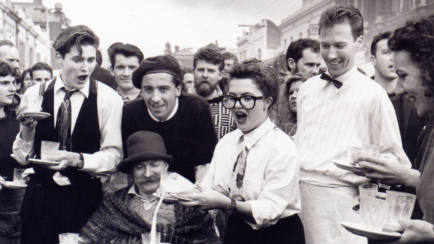 A black and white photo of the Waiters' Race, Brunswick St Parade, Fringe Festival 1988.