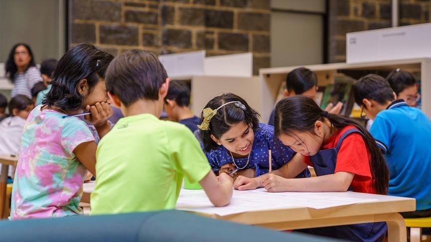 children working at desk