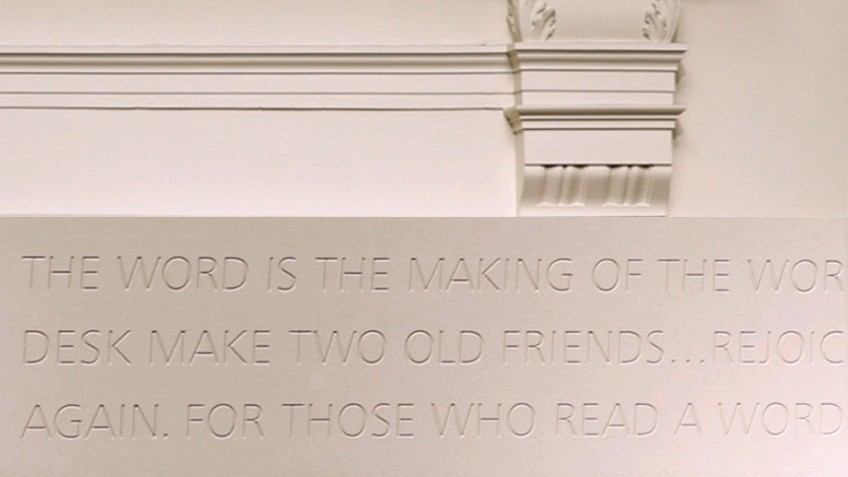 Inscribed words on a white wall