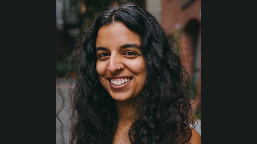 Woman smiling directly at camera