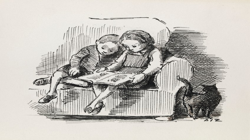 A boy and a girl read a book together on the couch