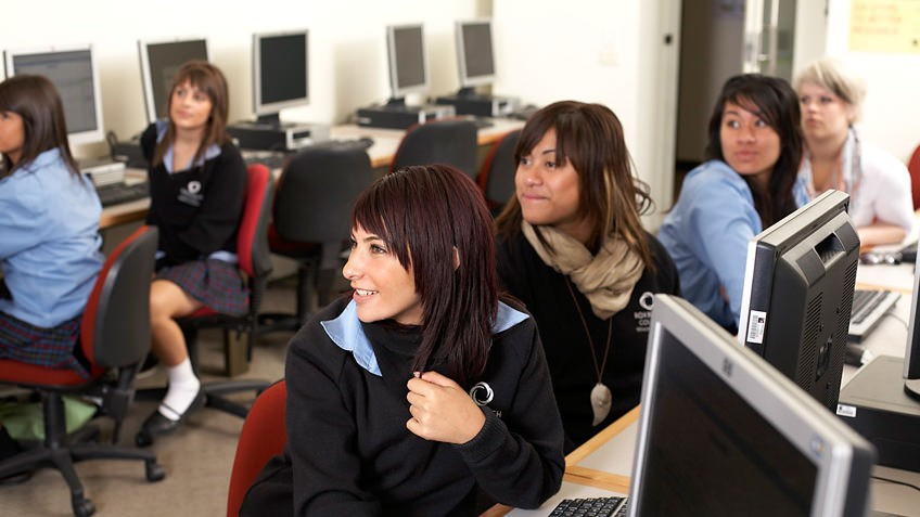 Mixed gender high school students in a computer lab