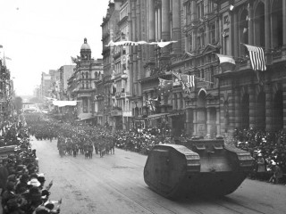 Black and white photo of WWI soldiers marching down Collins Street near the corner of Queen Street