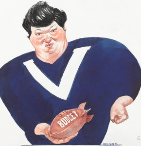 Newspaper cartoon of former Victorian premier Joan Kirner in football guernsey holding a football labelled Budget