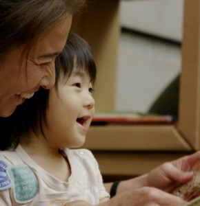 Woman and child reading a book together