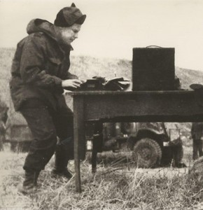 Harry Gordon, left, the youngest war correspondent in Korea, wrestles with his typewriter in the cold, with Ronald Monson of The Daily Telegraph