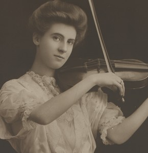 Black and white photo of a woman playing a violin