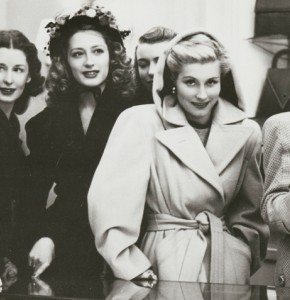 Shows a group of six elegantly dressed women, standing at the counter in K O Geiger, Shoes and Handbags, at 248 Collins Street, one of the women is holding a handbag.