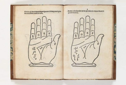 open book showing diagram of hands