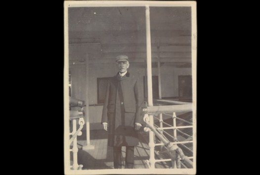 man standing on deck of boat