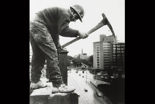 demolition worker holding pickaxe