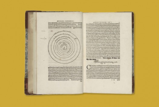 open book with celestial diagrams