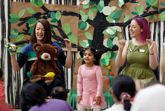 Presenters and child performing at storytime