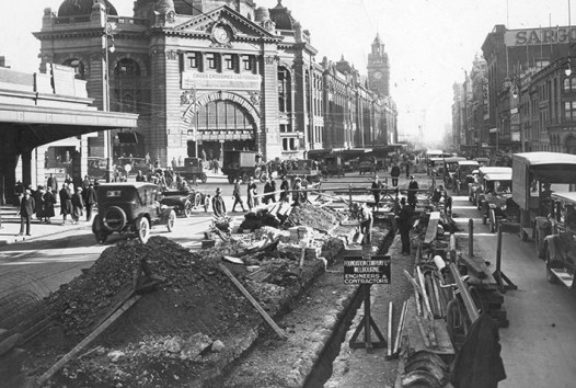 black and white photo of construction works outside Flinders Street station, Melbourne