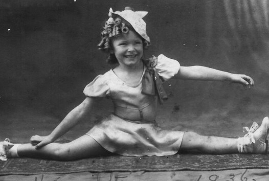 Photo of a little girl doing the splits