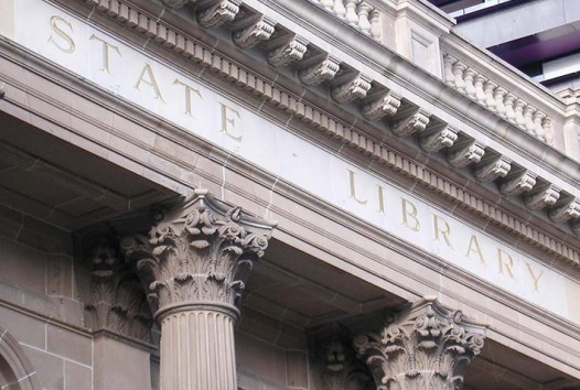 Photo of the facade of the library, with the words 'State Library' written in stone.
