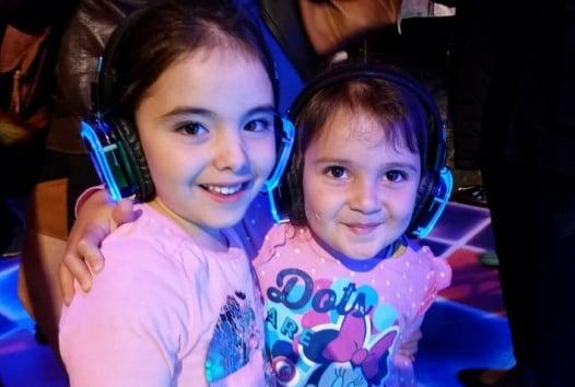 two children wearing headphones