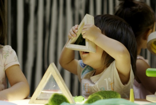 Colour photo of children playing with wooden blocks and toys