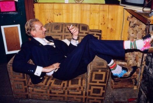 man reclining on armchair