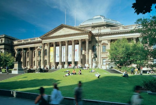 Colour photo of State Library Victoria facade and lawn on a sunny day