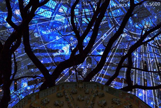 Photo of the library dome with a projection blue light with black trees mapped onto it