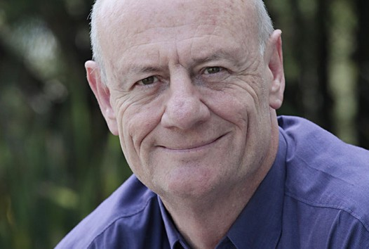Colour photograph of Tim Costello's face