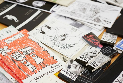 close-up of scattered zines and magazines